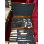 A double canteen of cutlery, with brass inset to the lid, including; meat knife and fork,