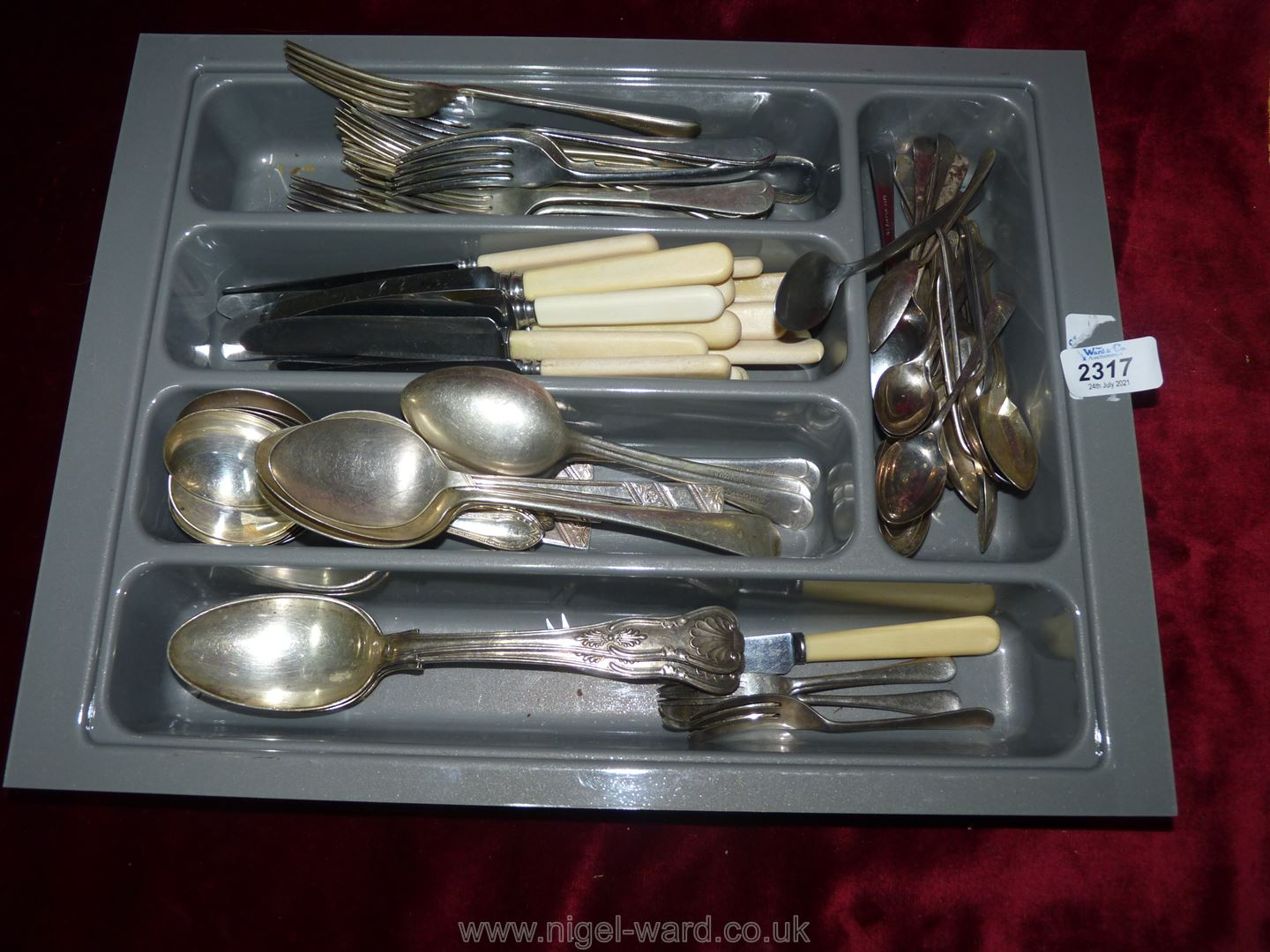 A cutlery tray and cutlery including grapefruit spoons, cake forks,