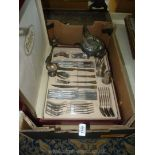 A boxed set of Prima cutlery in Carisbrooke design, three serving spoons, an EPNS condiment set,