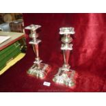 A pair of good plated Candlesticks with inserts, rounded corner square bases and plain stems,