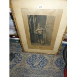 A carved gilt framed etching of a Court Jester,