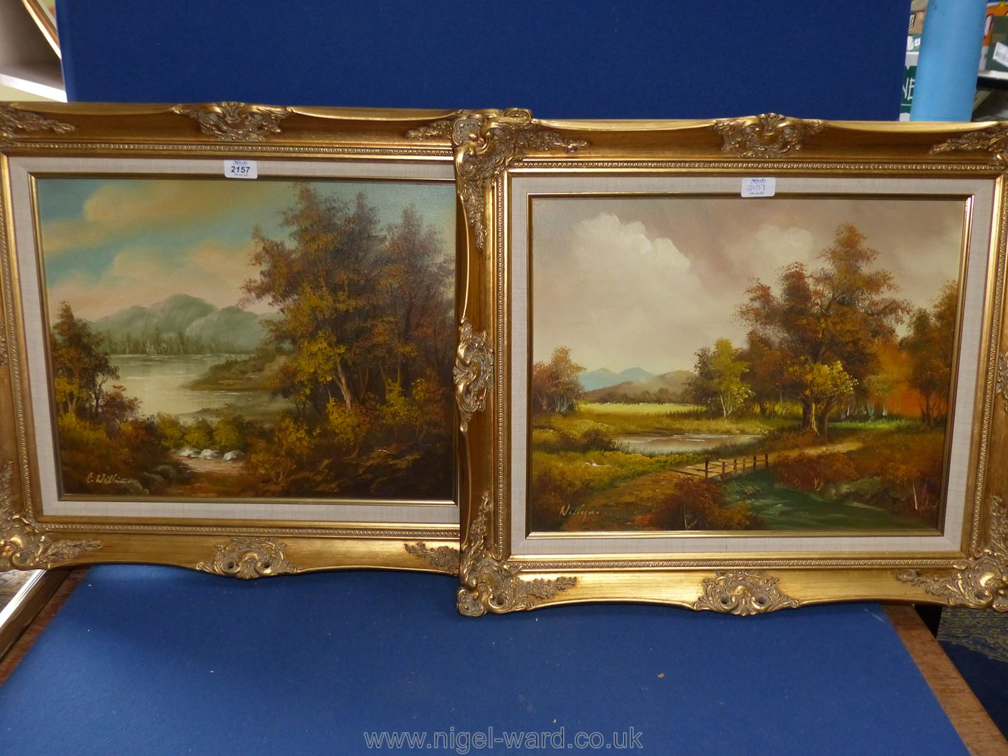 Two gilt framed Oil on canvas depicting river scenes, one signed C.