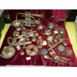 A box of brassware to include trumpet bells, taps, very large key, stirrups etc.