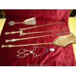 A brass companion set.