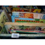 A box of children's books, history, cats, butterflies etc.
