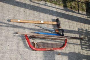 A sledgehammer, bar chisel, saws etc.