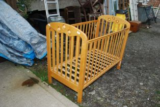 A Mothercare cot and Allen key.