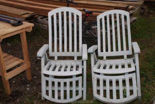 Two folding reclining garden chairs.