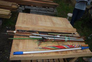 A fishing rod rests, gaff, antler walking stick, umbrella etc.