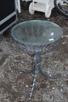 """A glass topped and wrought iron table, 17 1/2"""" diameter, and 25"""" high."""