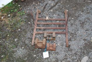 Three potato scale weights and a part fire grate.