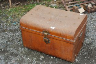 A metal travel trunk.