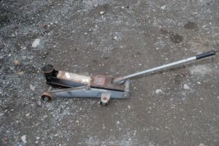 A hydraulic vehicle jack with handle.