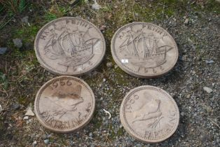 Four circular coin garden stepping stones in the form of half penny,