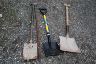 Two shovels, a spade and a metal bar.