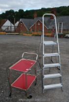 A two tier tea trolley and a four rung pair of aluminium steps.