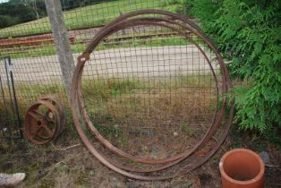 "A set of four metal wheel rims, 51"" diameter."