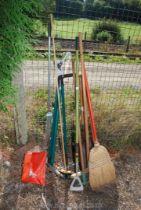 A quantity of garden tools including brooms, shovel, branch lopper, lawn shears, rake etc.