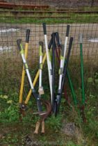 A quantity of lawn shears and bill hooks.