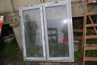 """A UPVC window with grey exterior and white interior, 52 1/2"""" wide x 57 1/4"""" high."""