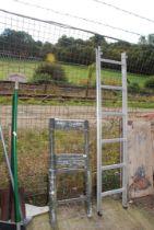 A folding surveyors ladder and a single six run aluminium ladder.