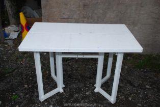 A folding plastic patio/ picnic table.