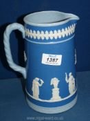 "A Dudson Staffordshire glazed Jasperware style pitcher in blue, 7 3/4"" tall."