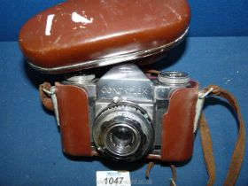A 1960's Carl Zeiss F 2.8 lens and Zeiss Ikon Contaflex camera.