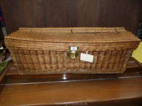 """A wicker picnic basket with brass clasp, possibly 1910, 33"""" x 10"""" x 12""""."""