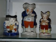 Three Staffordshire Toby jugs including the 'Snuff Taker',