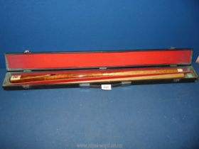 A cased Riley snooker Cue, made from ash.