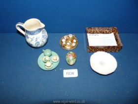 Two miniature 1950's dolls' tea sets; one with gilt lustre decoration the other carved wood.