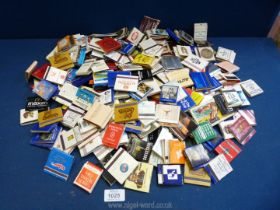 A large bag containing over 220 vintage collectable worldwide matchbooks, unused.