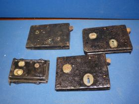 A collection of four Victorian rim locks.