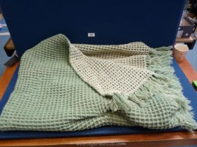 """Pure Welsh wool waffle blanket in green and cream with two fringe edges. 64"""" x 55""""."""