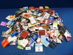 A large bag of over 350 vintage collectible worldwide match books, used.