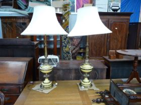 A pair of tall yellow and brass Art Deco style Lamps having petal decoration and a pair of large
