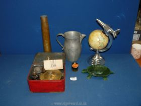 A vintage pewter water jug and brass shell casing dated 1951,