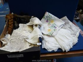 A large quantity of linen and lace (some embroidered) to include; tablecloths, napkins, etc.
