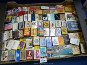 A large tray of over 170 vintage collectible worldwide matchboxes.