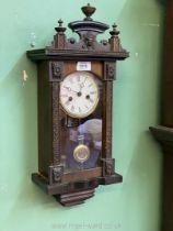 An Edwardian musical wall clock having Roman numerals, with key and pendulum, a/f.
