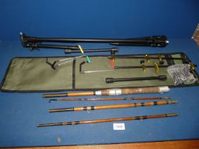 A wooden fishing rod and a Lixada rod rest in a canvas bag.