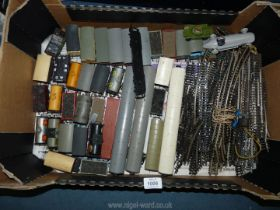 A box of 'OO' gauge train track and various carriages, some Tri-ang, various carts including; coal,