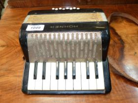 A child's vintage Hohner Mignon accordion, working.