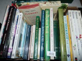 A box of gardening books.