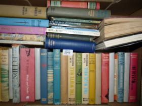 A box of novels to include; Ring of Bright & Water, The Blue Nile, The Fatal Impact, etc.