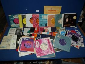 A quantity of 45 rpm records to include; Cats, Abba, Peter's & Lee, etc.