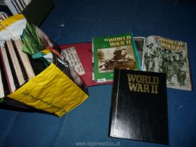 A bag containing 8 folders of World War II part works.