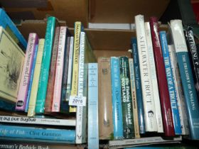 A box of fishing books to include; Trout in Troubled Waters, A Tide of Fish by Clive Gammon,