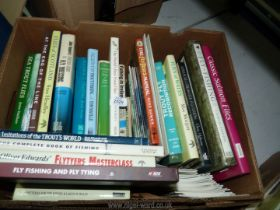 A box of fishing books to include; Classic Salmon Flies, Flies of Wales, Reservoir Trout Fishing,